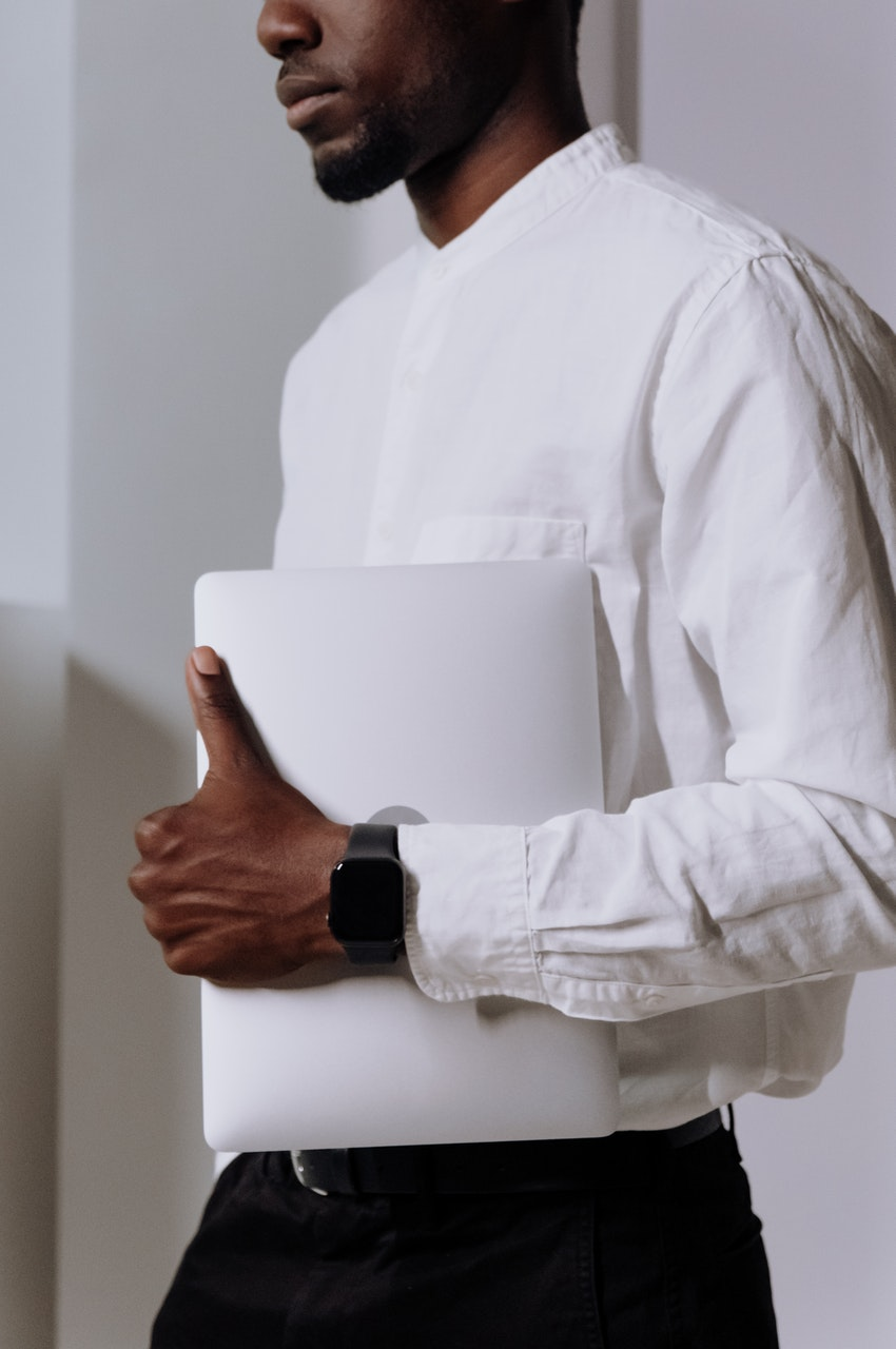 man in white shirt holding paper